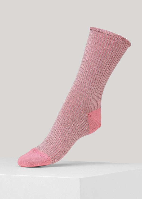Our Malene Rib Glitter sock in Pink is premium full glitter ribbed socks with elegant roll-top. They are made in premium Lenzing Viscose® yarn, with 180 needles fine gauge.