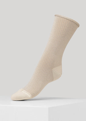 Our Malene Rib Glitter sock in Gold is premium full glitter ribbed socks with elegant roll-top. They are made in premium Lenzing Viscose® yarn, with 180 needles fine gauge.