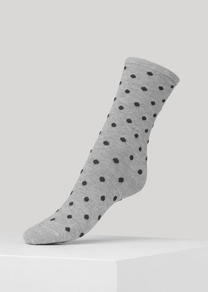 The soft full glitter Mei sock with dots in Silver/Dark Grey is made in super soft Lenzing Viscose® yarn made with  a 180 needles fine gauge.