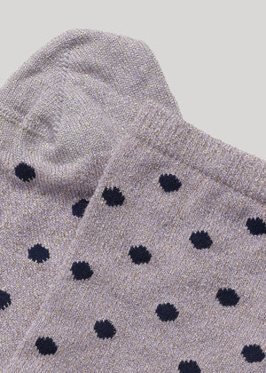 The soft full glitter Mei sock with dots in Purple/Navy is made in super soft Lenzing Viscose® yarn made with  a 180 needles fine gauge.