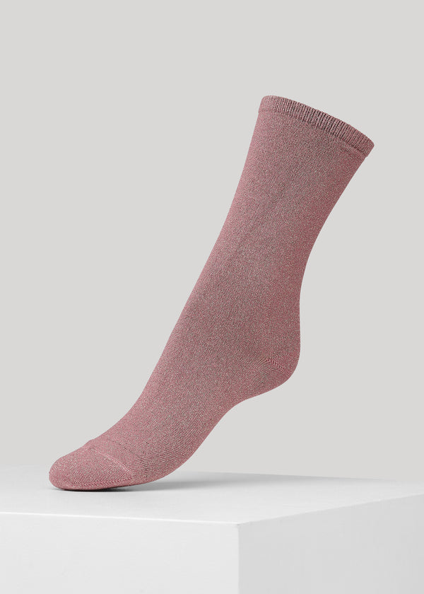 The soft full glitter Mei sock in Old Rose is made in super soft Lenzing Viscose® yarn made with  a 180 needles fine gauge.