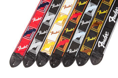 A grouping showing the 6 different colour monogrammed Fender straps, with one additional strap shown at the end.
