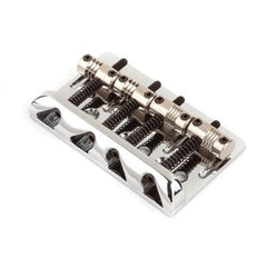 A Fender American Standard Bass bridge for a 4 string Bass. The kit includes the bridge plate, the saddles, as well as the intonation screws and springs.
