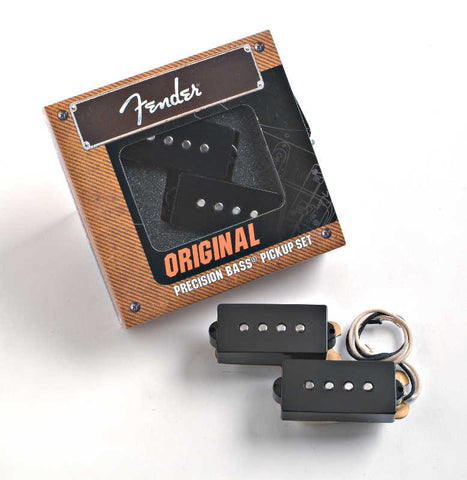A set of 2 black Fender Original Precision Bass pickups, shown in their packaging.
