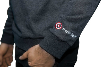 Close up of Parkit360 logo embroidery on Sweater