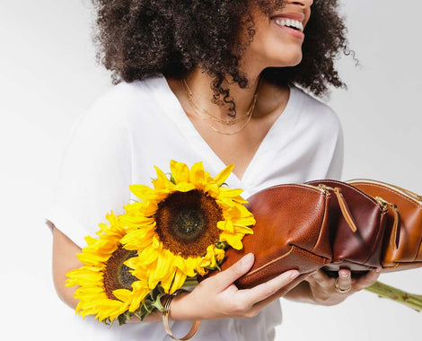 Genuine full grain leather makeup bag in merlot red, grizzly brown and honey brown with personalized monogram initials. Handmade by Portland Leather Goods.