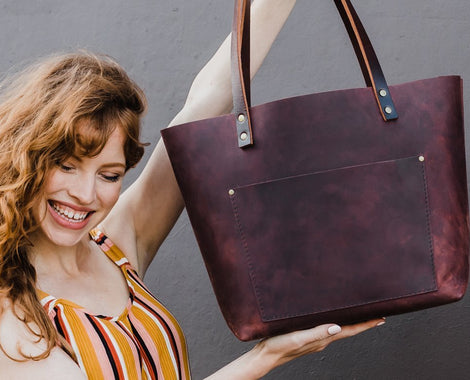 Women's Best Sellers Happy girl holding merlot classic leather tote with outside pocket handmade in portland oregon