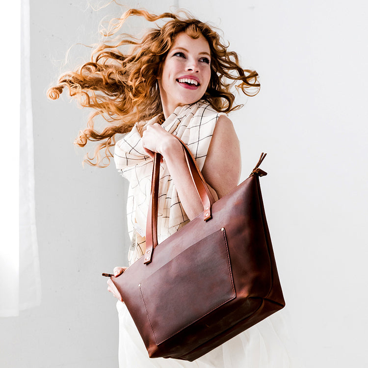 Leather Classic and & Zipper Totes bag with monogram and tassel and girl drinking coffee