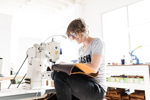 Jess sewing a leather tote bag in Portland Oregon