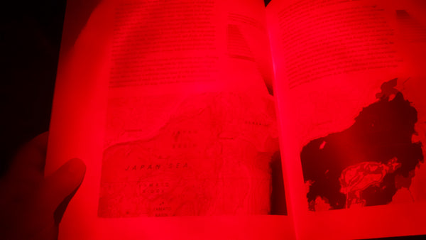 Red LED aimed directly at the page