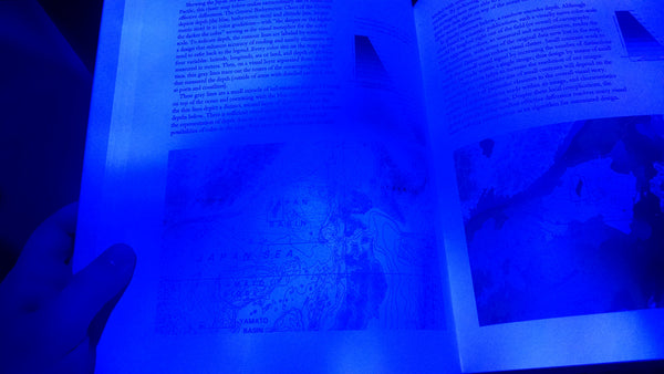 Blue LED pointing directly at the page