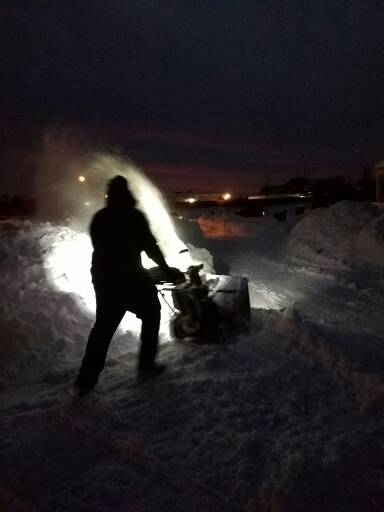 Olight S20R Baton shining on snow blower