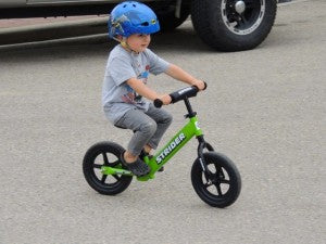 Kid on Strider Bike