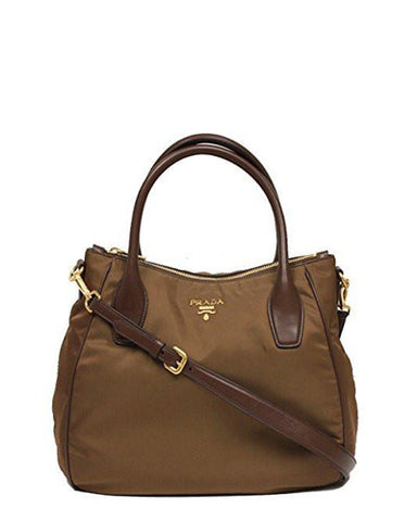 f60e08e52126 The gold tone hardware, Prada logo jacquard inner lining, twin rolled  handles and the adjustable shoulder strap makes this a must have.