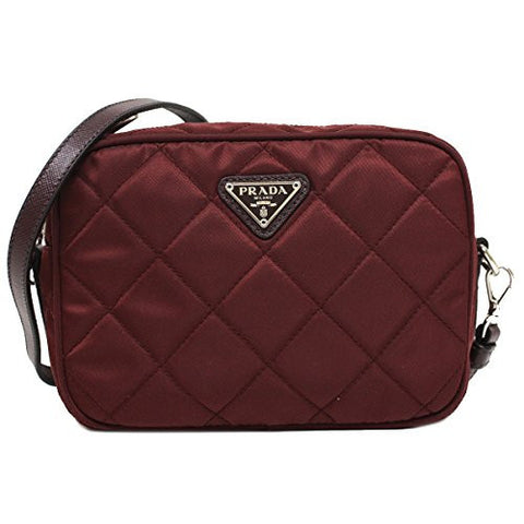be4d09851dc2 The quilted design and the silver tone hardware add to the chic appeal of  this crossbody bag. $1,048.00. Prada Tessuto Saffiano Pink Nylon Leather  Shopping ...