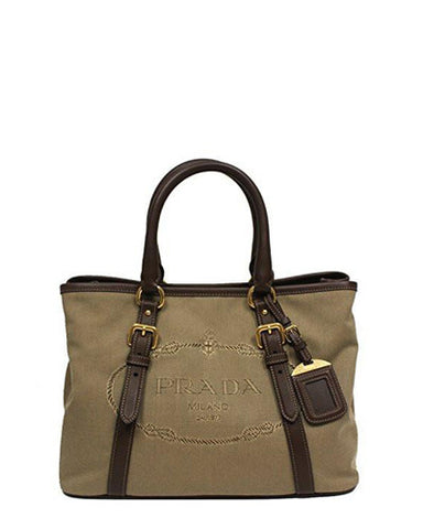 88c6112ec8d44d ... this bag features brown leather trim detailing with gold tone buckle.  Along with the rolled handles, it also comes with removable shoulder straps  and ...
