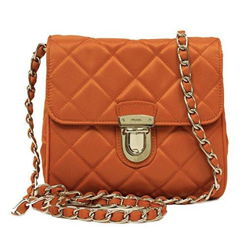 321257128ac9 ... house of Prada and features a leather chain shoulder strap that is  detachable. The quilted design of the bag coupled with the gold tone  hardware adds to ...