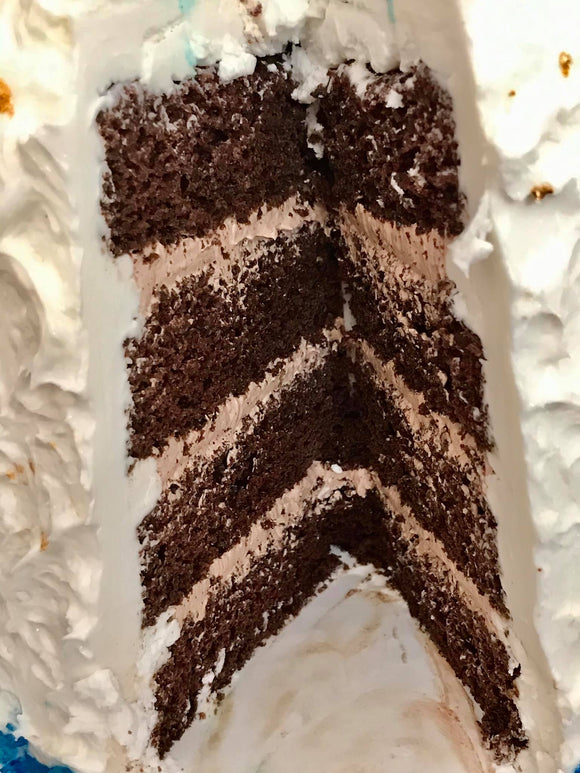 Four Layer Belgian Chocolate Cake filled with Belgian Chocolate Mousse Frosted in our Signature Line Madagascar Vanilla Bean Icing