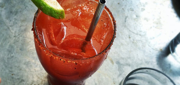 Craft beer cocktail, the Michelada or Mexican Bloody Mary made with Mexican lager, Clamato, lime juice and Tajin seasoning