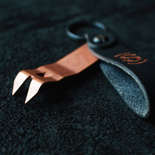 Snake Bite Bottle Opener Anniversary Edition Midnight Copper - Angle