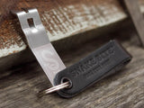 Black leather strap with churchkey bottle opener
