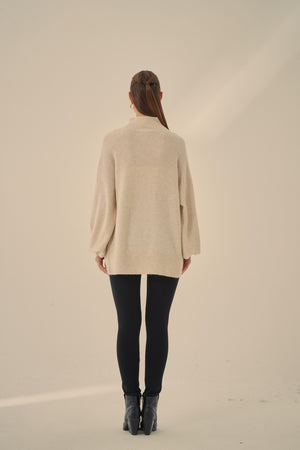 STATEMENT SLEEVE KNIT
