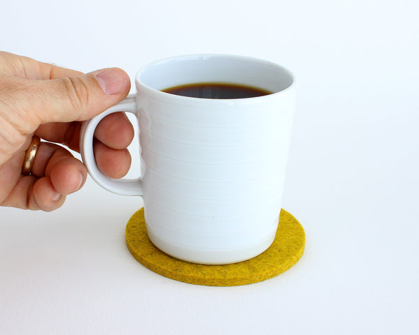 round felt coaster in use