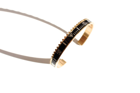 Marine steel bangle inspired by Submariner bezel in gold and black