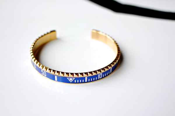 Marine steel bangle inspired by Submariner bezel in Gold Blue