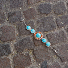 "Load image into Gallery viewer, 7.5"" Reconstituted Turquoise and Coral Sunburst Toggle Bracelet"