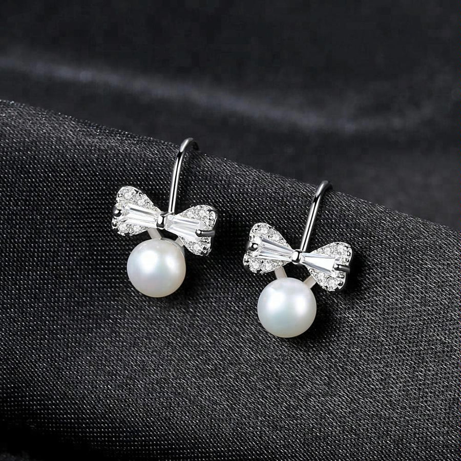 Sterling Silver Small Ribbon Natural Pearl Studs - Enumu