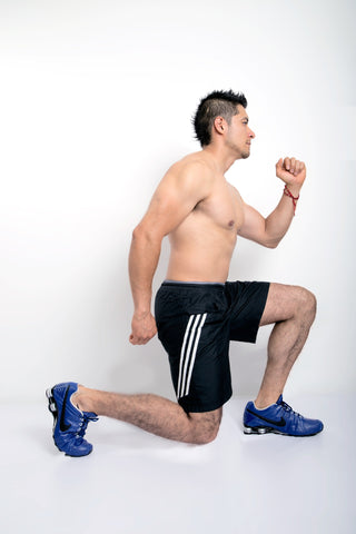 man doing step lunges