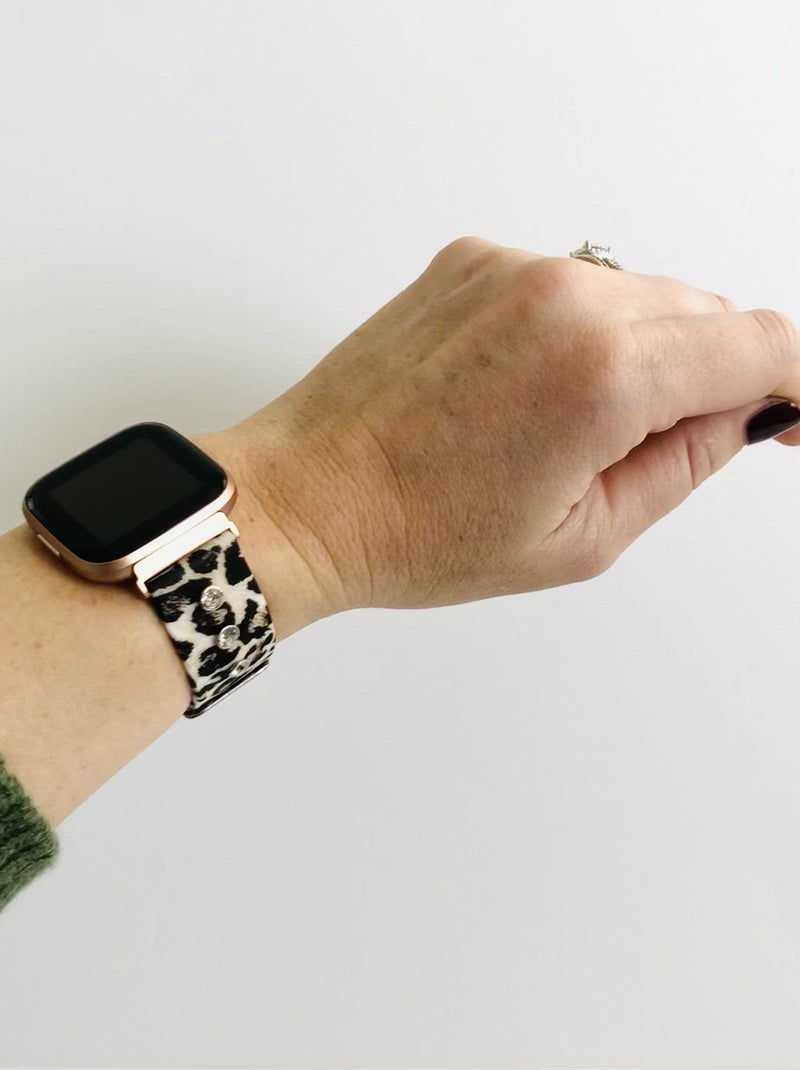 This gorgeous leopard print, silicone band for the Fitbit Versa. This band has a touch of bling that you have come to expect from a Copper Robin Watch . Three beautiful glass crystal studs adorn each side of the band. If bling is not your thing, you may also purchase the diva with out crystal studs.