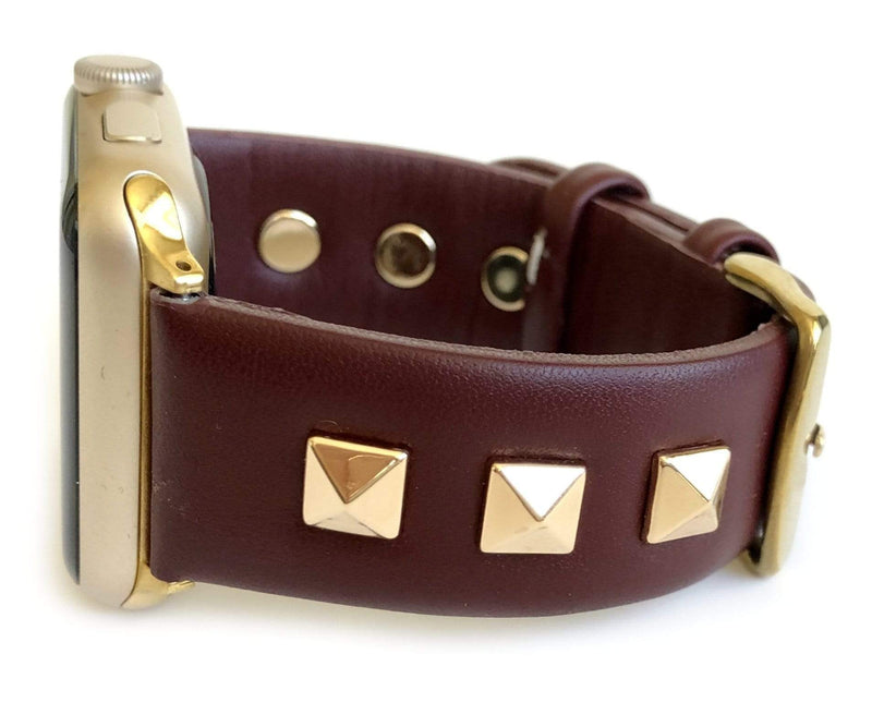 Beautiful BURGUNDY top grain genuine LEATHER, STUDDED Apple Watch Band. This watch band features a stainless steel buckle and is adorned with three metal studs on each side. Stud color choices include Silver, Gold, and Rose Gold.  This watch band fits all series of Apple Watches. Comes in sizes 38/40 and 42/44