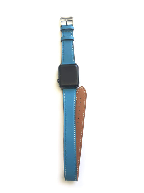 "Men's and Women's BLUE  AND CREAM genuine leather strap. Leather strap contains white stitching around entire outer edge. Strap is designed to wrap around the wrist twice creating a solid cuff look. This Apple Watch Band fits all apple series watches sized 42/44mm. Fits wrist sizes 6.5""-8"""