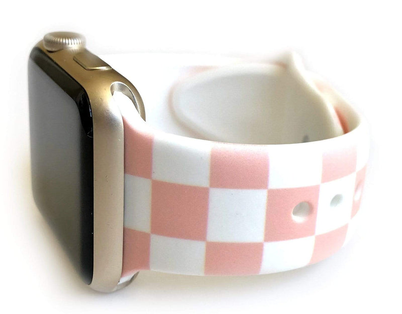 "This sporty light pink and white checkerboard silicone apple watch band is the must have band of the season! Looks great on men, women and children. Sizes: Small/Medium will fit wrist size 5""-7.5"" Medium/Large will fit wrist sizes 6""-8.25"""