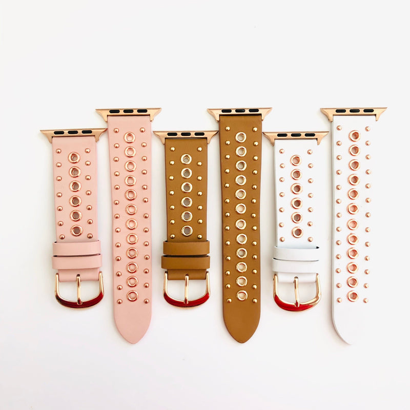 "This genuine pink leather with rose gold rivets and studs Apple Watch Band will absolutely go with EVERYTHING! Size fits 5.5""-8"" Available in one size that fits 38/40/42/44mm."