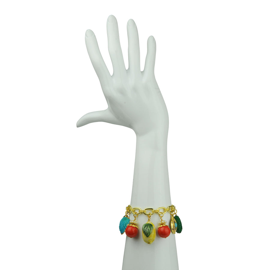 Katerina Psoma charm bracelet with lemon ceramic, beads and chain details