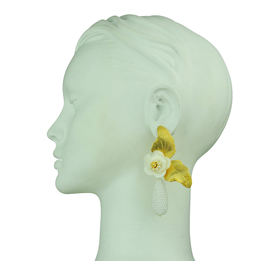 katerina psoma flower statement earrings with white dangle drops close up