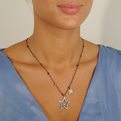 Short chain necklace with enamel star adorned with multi color crystals