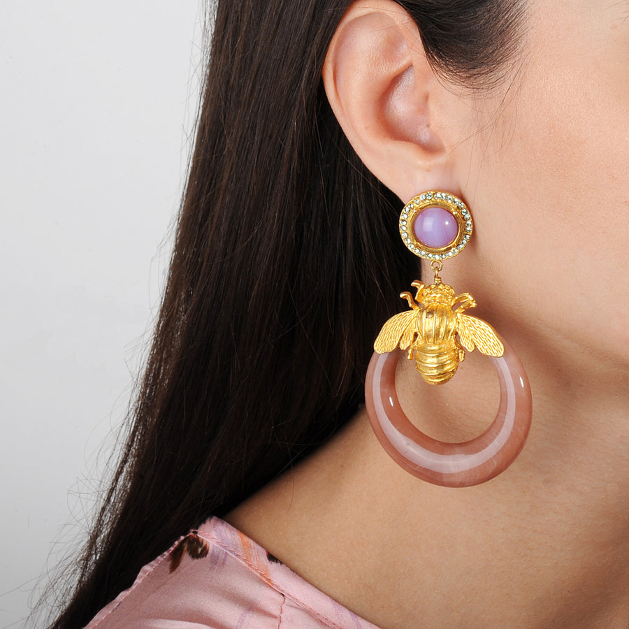 beige acrylic hoops with gold plated metal bees, rosettes with crystals katerina psoma 925 silver studs statement earrings