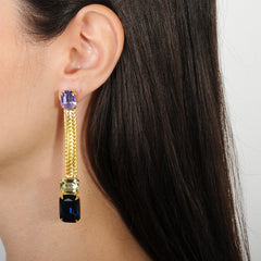 metal dangle earrings with blue, yellow and violet crystals katerina psoma on model