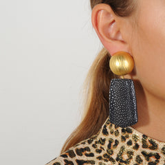 gold plated clip earrings with  black stingray drops katerina psoma statement earrings