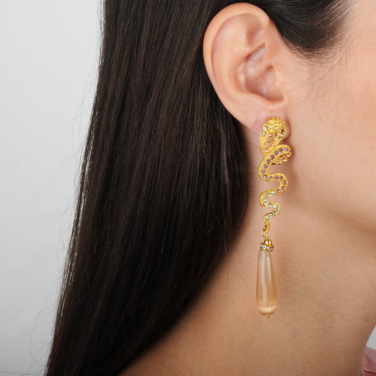 Statement gold plated snake earrings with crystals and cat's eye beige drops katerina psoma