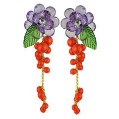 statement clip dangle earrings with faceted purple flowers and orange coral beads katerina psoma