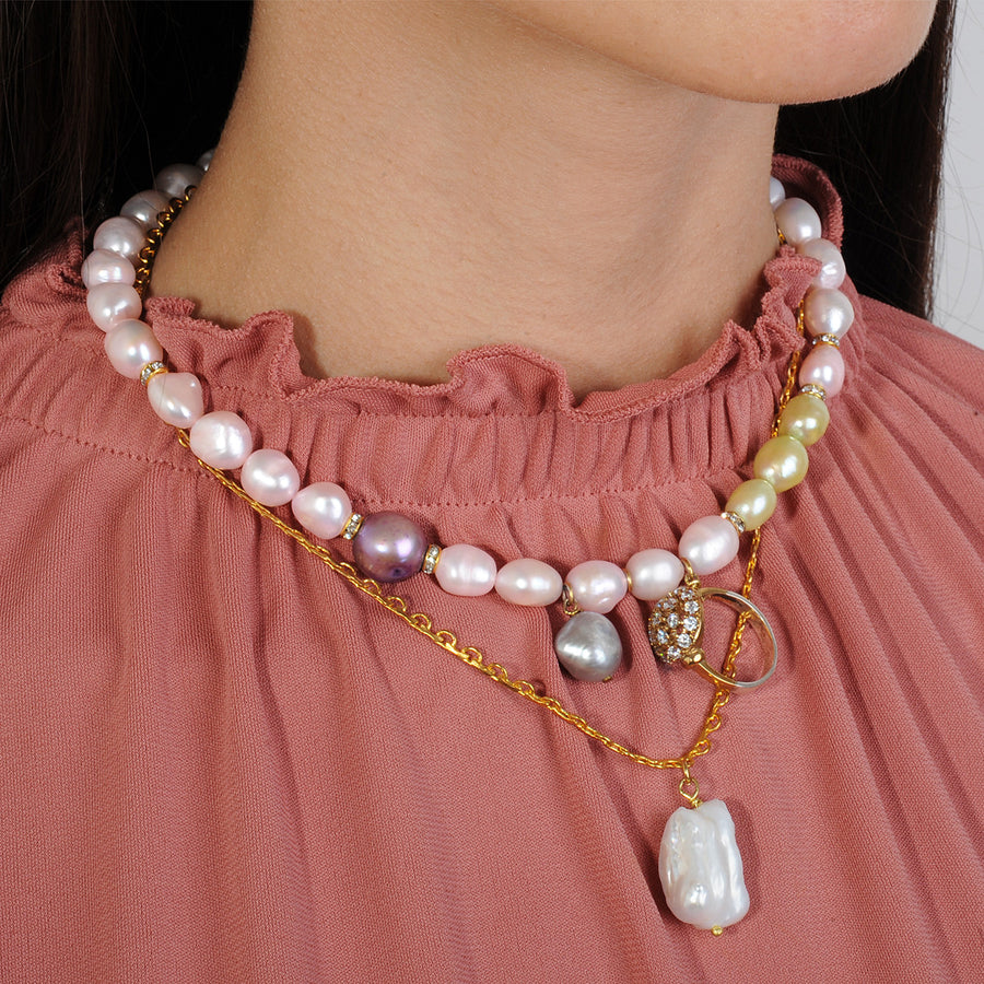 Short pink fresh water pearl necklace with chains and charms katerina psoma on model
