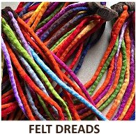 A mixture of four different coloured felt dreadlocks hair scrunchies with the words Felt Dreads beneath