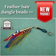 Single handmade feather dangle dreadlock hair bead displayed on aqua felt background