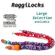 Two slightly different styled red and purple, colourful, handmade patterned Raggi Locks and synthetic dreadlocks, with beaded end shown on white background