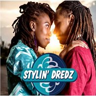 Two people with dreadlocks face to face, with Stylin' Dredz logo in lower half of image